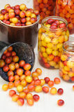 Preserving Mirabelle plums - jars of homemade fruit preserves royalty free stock images