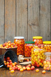 Preserving Mirabelle plums - jars of homemade fruit preserves. Mirabelle prune Royalty Free Stock Images