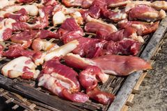 Preserving pork meat by dry with Sun-dried on bamboo basket weav. E palat Stock Photo