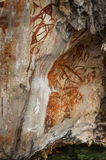 Preshistoric petroglyph rock paintings in Raja Ampat, West Papua, Indonesia. Aborigines from Australia left their markings in the form of rock paintings in and stock photo