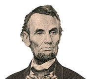 President Abraham Lincoln portrait (Clipping path). Portrait of former U.S. president Abraham Lincoln as he looks on five dollar bill obverse. Clipping path royalty free stock photo