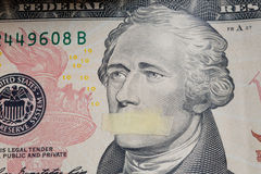 President Alexander Hamilton with mouth closed on the banknote of ten dollars USA. Portrait of the American president Alexander Hamilton with mouth closed on the Royalty Free Stock Photography