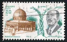 President Anwar Sadat. EGYPT - CIRCA 1977: stamp printed by Egypt, shows President Anwar Sadat, Dome of the rock, circa 1977 royalty free stock image