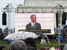 President Barack Obama op het Grote Scherm Stock Afbeeldingen