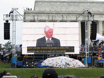 President Bill Clinton on the Big Screen Stock Image