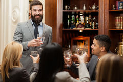 President of company toasting on the job was done successfully Royalty Free Stock Photos