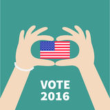 President election day 2016. Voting concept. Hands holding american flag. Isolated Green background Flat design Card Royalty Free Stock Photography