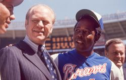 Gerald Ford and Henry Aaron. President Gerald Ford with Braves legend Hank Aaron. Image taken from color slide Royalty Free Stock Photos