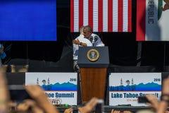 President Obama Embraces Senators Reid at 20th Annual Lake Tahoe Summit. President Barack Obama embraces Senator Harry Reid on stage at the 20th Annual Lake Stock Photography