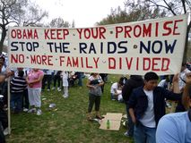 President Obama's Promise. Photo of hispanic people protesting unfair immigration laws at the mall in washington dc. on 3/21/10.  President Barack Obama has Stock Photography