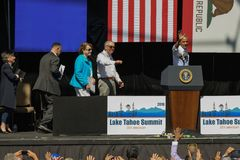 President Obama Waves at 20th Annual Lake Tahoe Summit. President Barack Obama waves to sell-out crowd at the 20th Annual Lake Tahoe Summit at Harvey's Lake Stock Image