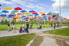 President Park in Astana, Kazakhstan. Alley colored umbrellas. The existing President Park of Astana should see more action and life in the future. Because the Stock Photography