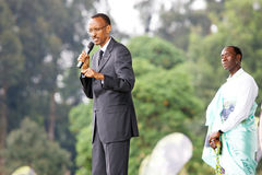 President Paul Kagame and actor Don Cheadle. The President of Rwanda Paul Kagame and the american actor  Don Cheadle, behind him, performed the opening speach at Royalty Free Stock Photo