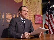 President Richard Nixon made of Wax. Wax figure Richard Nixon reading documents with american flag at desk Stock Photo