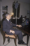 President Ronald Reagan. Seated and preparing for an interview Royalty Free Stock Photo