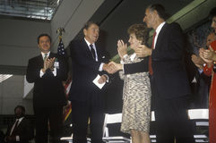 President Ronald Reagan, Mrs. Reagan and California governor George Deukmejian applaud Ronald Reagan Stock Photography