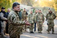 President of Ukraine Petro Poroshenko communicates with soldiers Stock Photo