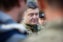 President of Ukraine Petro Poroshenko communicates with soldiers Royalty Free Stock Image