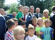 President of Ukraine Petro Poroshenko. Visited Lviv region.  surrounded by children Stock Photos