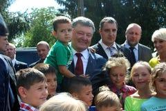 President of Ukraine Petro Poroshenko. Visited Lviv region. surrounded by children Royalty Free Stock Images