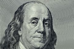 Benjamin Franklin close-up on a gray background. President of the United States Benjamin Franklin close-up royalty free stock photos