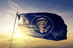 President of the United States flag textile cloth fabric waving on the top sunrise mist fog. Beautiful royalty free stock images