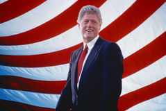 President William Jefferson Clinton in front of American flag stripes Stock Image