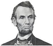 Presidenten Abraham Abe Lincoln vänder mot ståenden på iso för räkningen för dollar 5 Arkivfoton