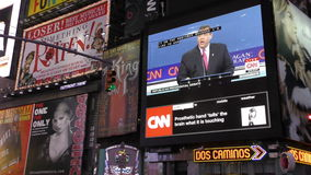 Presidential debate on outdoor TV. New York,USA - September 16, 2015: Crowds in New York City's Times Square watch GOP presidential debate on outdoor screens stock footage