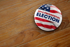 2016 Presidential Election Button. 3D illustration of a political button for the US presidential election in 2016 on wooden surface Royalty Free Stock Image