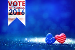 Presidential Election Vote 2016 in USA with American flag Heart. Shapes on abstract light glitter Royalty Free Stock Image