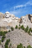 Presidential sculpture at Mount Rushmore national memorial, USA. Blue sky background. Vertical layout. Stock Photos