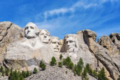 Presidential sculpture at Mount Rushmore national memorial, USA. Sunny day, blue sky. Stock Photo