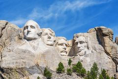 Presidential sculpture at Mount Rushmore national memorial, USA. Sunny day, blue sky. Stock Photography