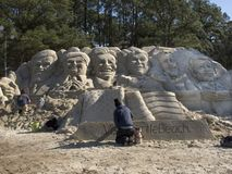 Presidential Sculptures. Myrtle Beach, SC - January 16: Workers put finishing touches on sand sculptures especially created in Myrtle Beach, South Carolina, for Royalty Free Stock Images