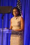 Presidentsfru Michelle Obama som ger ett anförande fotografering för bildbyråer