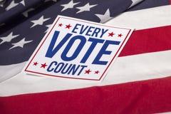 Presidentvalet röstar och amerikanska flaggan Royaltyfria Bilder