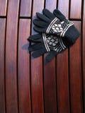 Presidenza di legno con i guanti Immagine Stock