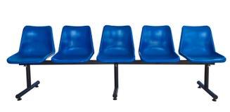 Presidenze di plastica blu isolate su bianco Fotografia Stock Libera da Diritti