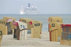 Presidenze di spiaggia incappucciate Fotografia Stock