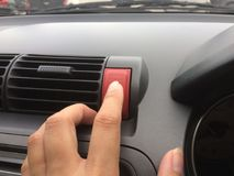 Presiona la parada de emergencia en el coche foto de archivo libre de regalías