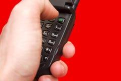 Presionar el botón ACEPTABLE del teléfono Imagen de archivo libre de regalías