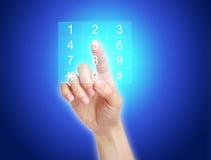 Presionar el cojín dominante del número en la pantalla Foto de archivo