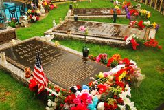 The Presleys` final resting place. The Final Resting Places for Elvis Presely and His Family are decorated with flowers and gifts brought by fans to Graceland stock image