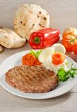 Presliced traditional burger patty called pljeskavica, Royalty Free Stock Images