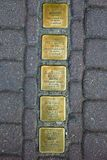 Presov in Slovakia. Bronze plates with names. Presov, Slovakia. 09 AUGUST 2015. Bronze plates in pavement near the houses of people who was deportet to nazi Royalty Free Stock Image