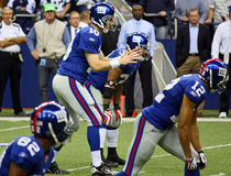 Pressão das esperas de Giants Eli Manning dos cowboys do centro Fotos de Stock