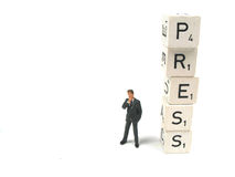 Press. A figurine standing beside the word press Royalty Free Stock Photography