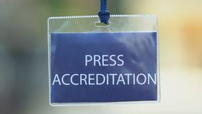 Press accreditation pass in cover, mass media, journalist card, authorization. Stock footage stock video footage