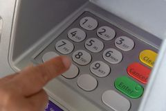 Press ATM EPP keyboard. Intimate female hand Enter the PIN / password on the ATM / bank keypad stock photography